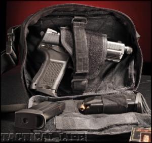pistol dalam tas